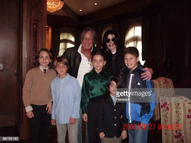 In this handout photo provided by Mohamed Hadid singer Michael Jackson poses with real estate developer Mohamed Hadid Hadid's children and Jackson's...