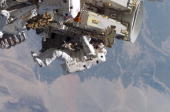 In this handout photo provided by NASA Astronaut Heidemarie M StefanyshynPiper STS115 mission specialist releases the restraints on the forward Solar...