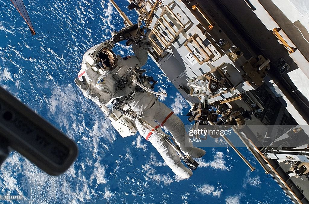 In this handout photo provided by NASA Astronaut Rick Mastracchio STS118 mission specialist participates in the mission's third planned session of...