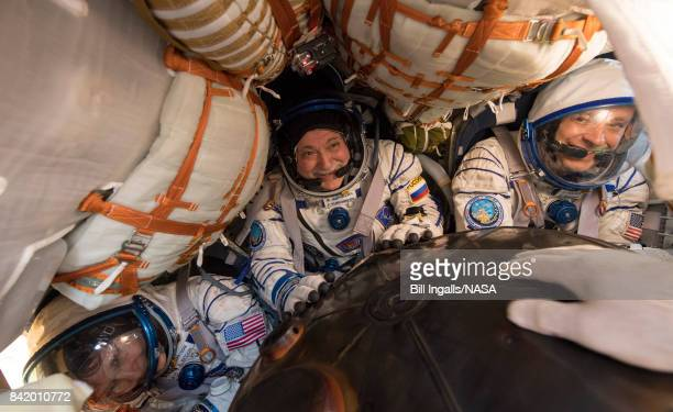 In this handout photo provided by NASA Expedition 52 Flight Engineer Peggy Whitson left Commander Fyodor Yurchikhin of Roscosmos center and Fight...