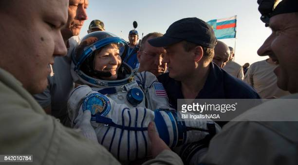 In this handout photo provided by NASA Expedition 52 NASA astronaut Peggy Whitson is helped out of the Soyuz MS04 spacecraft just minutes after she...