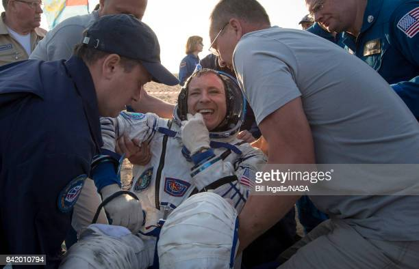 In this handout photo provided by NASA Expedition 52 NASA astronaut Jack Fischer is helped out of the Soyuz MS04 spacecraft just minutes after he and...