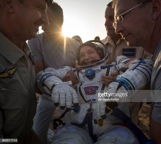 In this handout photo provided by NASA Expedition 52 Roscosmos cosmonaut Fyodor Yurchikhin is helped out of the Soyuz MS04 spacecraft just minutes...