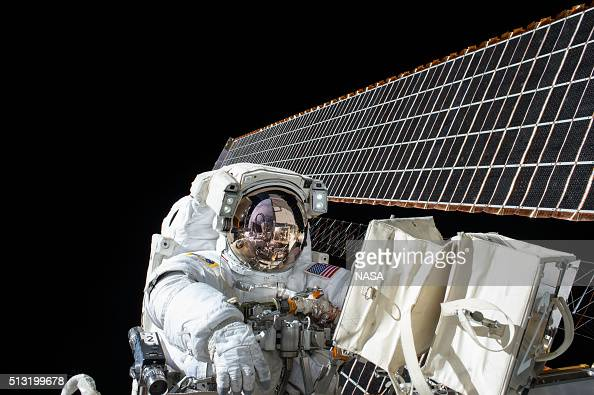 In this handout photo provided by NASA NASA astronaut Scott Kelly works outside of the International Space Station during a spacewalk on November 6...