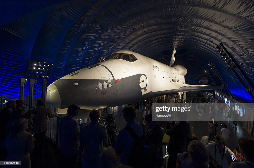 In this handout photo provided by NASA, the space shuttle Enterprise is seen shortly after the grand opening of the Space Shuttle Pavilion at the Intrepid Sea, Air & Space Museum on July 19, 2012 in New York City. Photo by