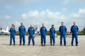 In this handout photo provided by NASA the STS121 crew Mission Specialists Lisa Nowak and Michael Fossum Pilot Mark Kelly Commander Steven Lindsey...