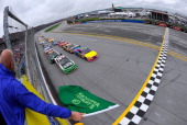 In this handout photo provided by NASCAR Travis Pastrana driver of the Roush Fenway Racing Ford and Austin Dillon driver of the AdvoCare Chevrolet...