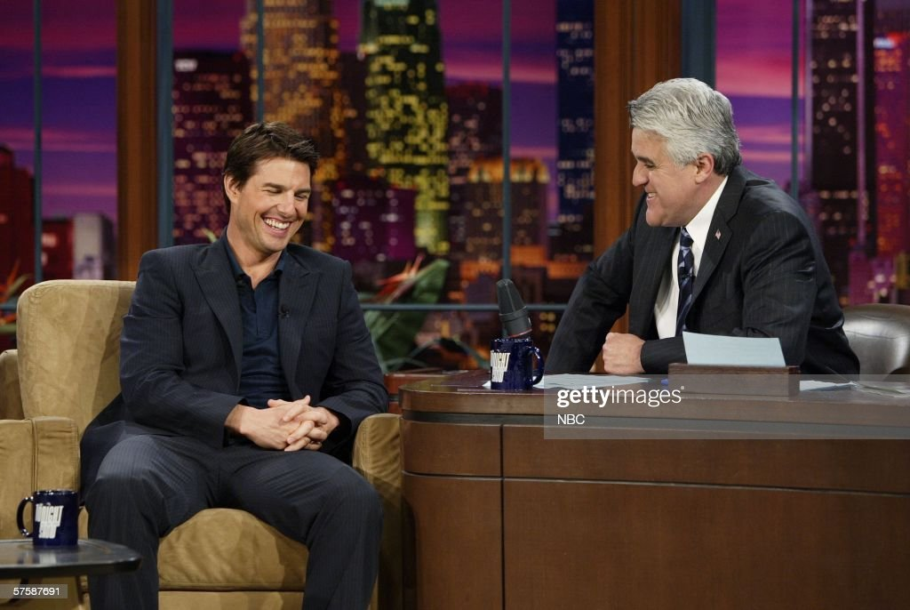 In this handout photo provided by NBC actor Tom Cruise shares a laugh with host Jay Leno during an appearance on 'The Tonight Show With Jay Leno' May...