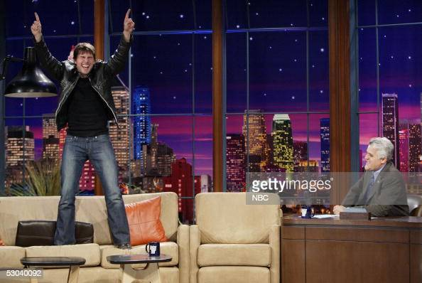 In this handout photo provided by NBC actor Tom Cruise stands on the couch during an interview on 'The Tonight Show with Jay Leno' June 8 2005 in...