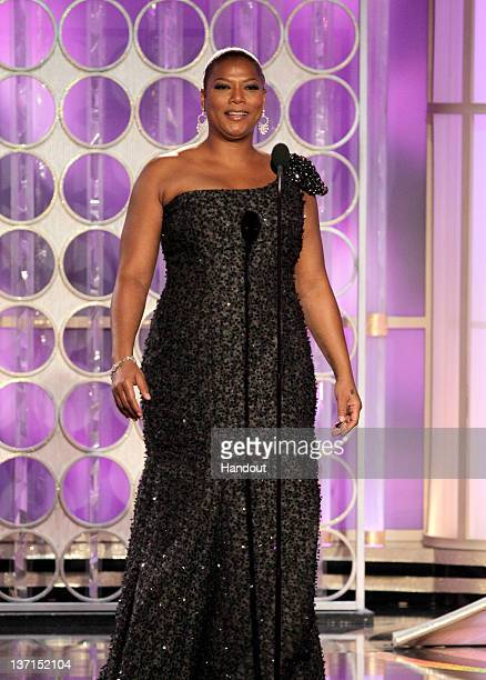 In this handout photo provided by NBC actress Queen Latifah presents an award onstage during the 69th Annual Golden Globe Awards at the Beverly...