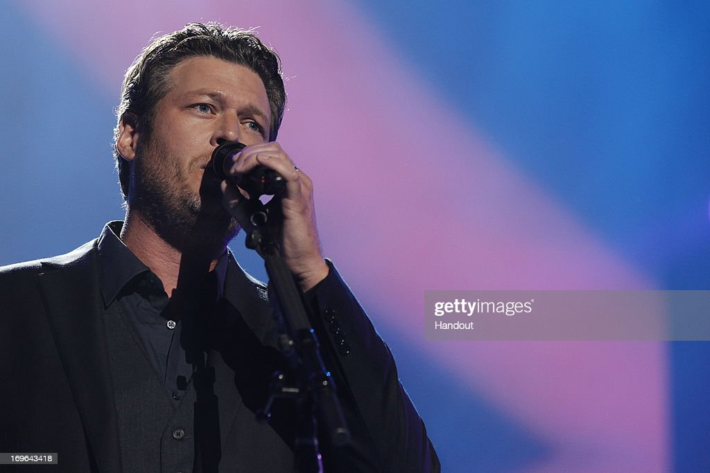In this handout photo provided by NBC, <a gi-track='captionPersonalityLinkClicked' href=/galleries/search?phrase=Blake+Shelton&family=editorial&specificpeople=2352026 ng-click='$event.stopPropagation()'>Blake Shelton</a> performs during the Healing in the Heartland: Relief Benefit Concert held at the Chesapeake Arena on May 29, 2013 in Oklahoma City, Oklahoma.