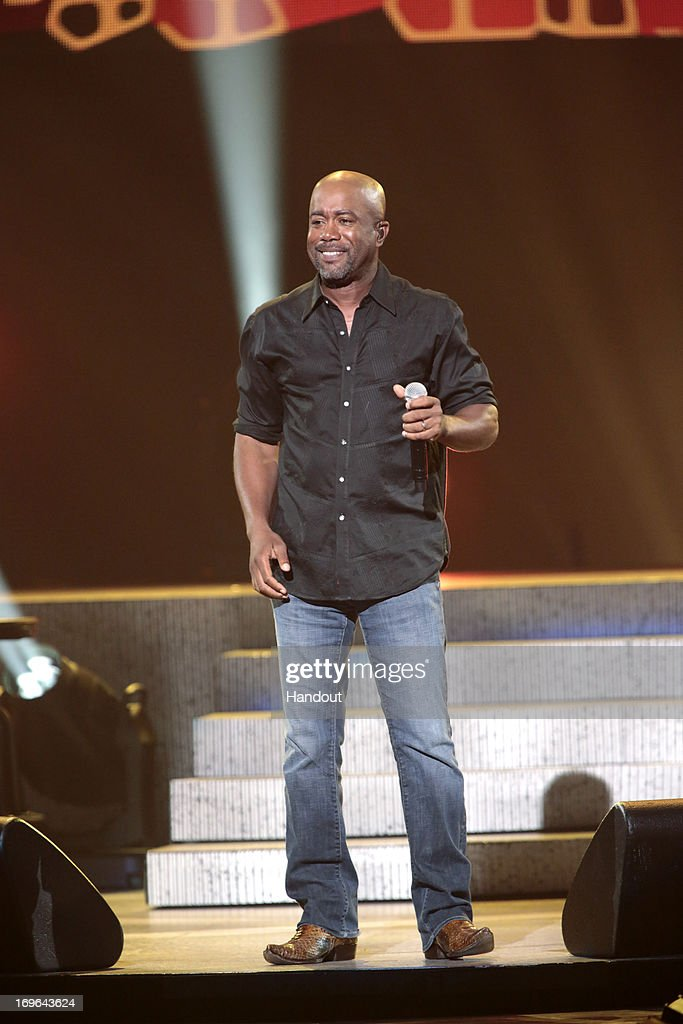 In this handout photo provided by NBC, <a gi-track='captionPersonalityLinkClicked' href=/galleries/search?phrase=Darius+Rucker&family=editorial&specificpeople=215161 ng-click='$event.stopPropagation()'>Darius Rucker</a> performs during the Healing in the Heartland: Relief Benefit Concert held at the Chesapeake Arena on May 29, 2013 in Oklahoma City, Oklahoma.