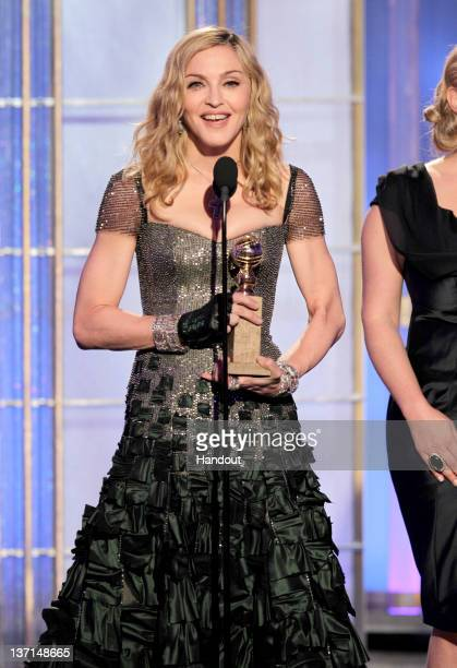 In this handout photo provided by NBC Madonna accepts award for Best Original Song Motion Picture ' Masterpiece' from WE onstage during the 69th...