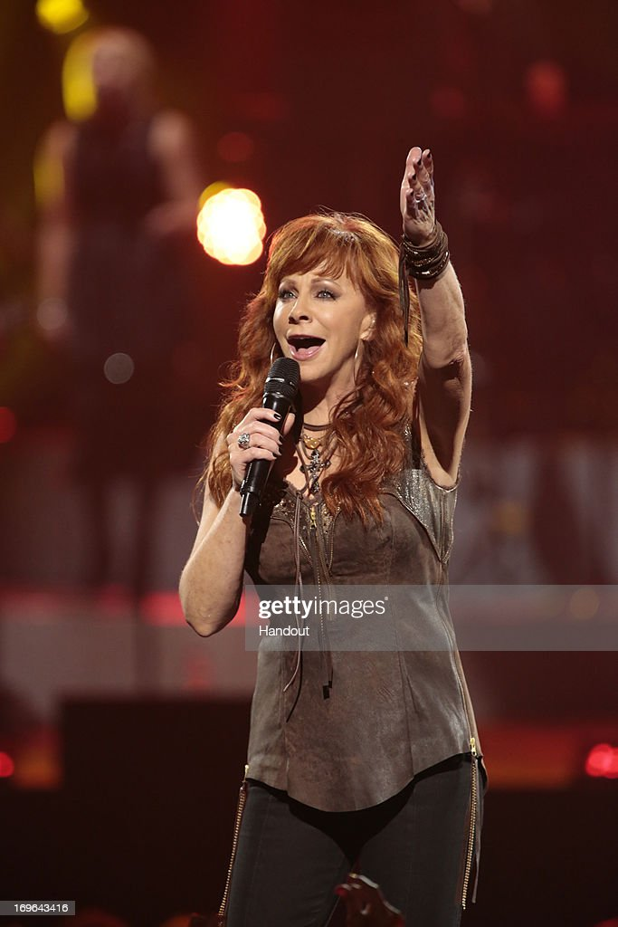 In this handout photo provided by NBC, Reba McEntire McEntire performs during the Healing in the Heartland: Relief Benefit Concert held at the Chesapeake Arena on May 29, 2013 in Oklahoma City, Oklahoma.