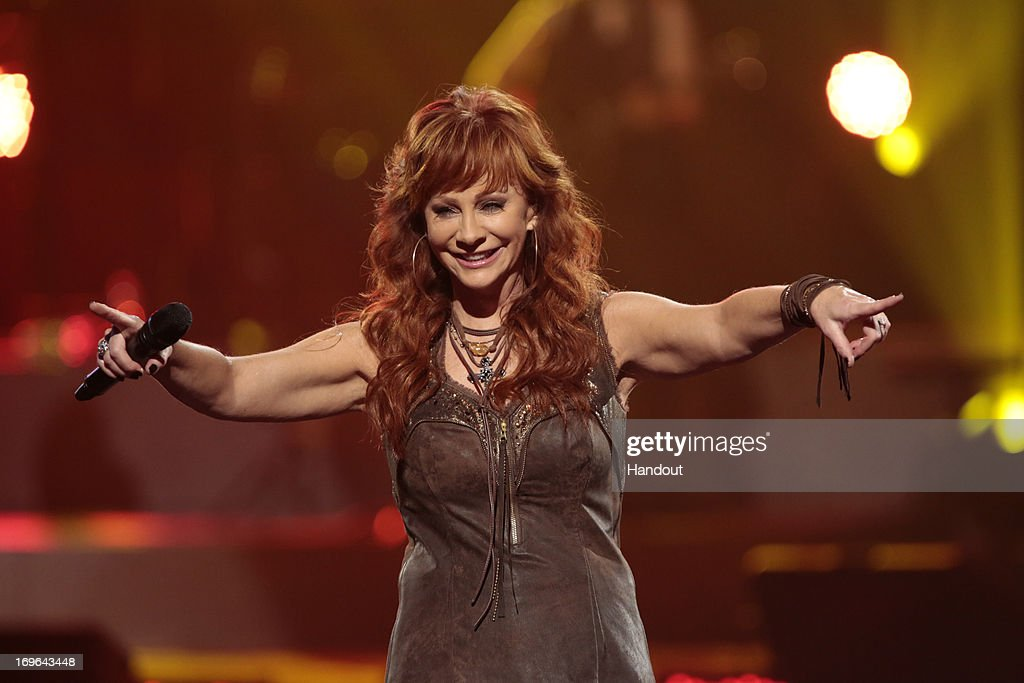 In this handout photo provided by NBC, Reba McEntire performs during the Healing in the Heartland: Relief Benefit Concert held at the Chesapeake Arena on May 29, 2013 in Oklahoma City, Oklahoma.