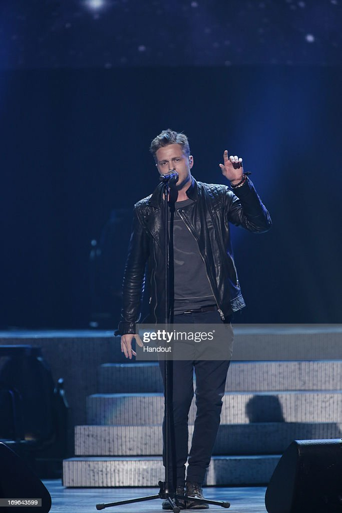 In this handout photo provided by NBC, <a gi-track='captionPersonalityLinkClicked' href=/galleries/search?phrase=Ryan+Tedder&family=editorial&specificpeople=4651553 ng-click='$event.stopPropagation()'>Ryan Tedder</a> performs during the Healing in the Heartland: Relief Benefit Concert held at the Chesapeake Arena on May 29, 2013 in Oklahoma City, Oklahoma.