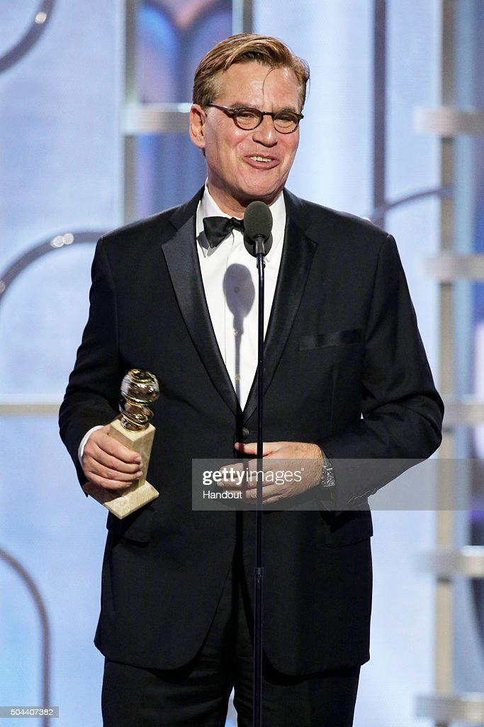 In this handout photo provided by NBCUniversal Aaron Sorkin accepts the awards for Best Screenplay Motion Picture 'Steve Jobs' onstage during the...