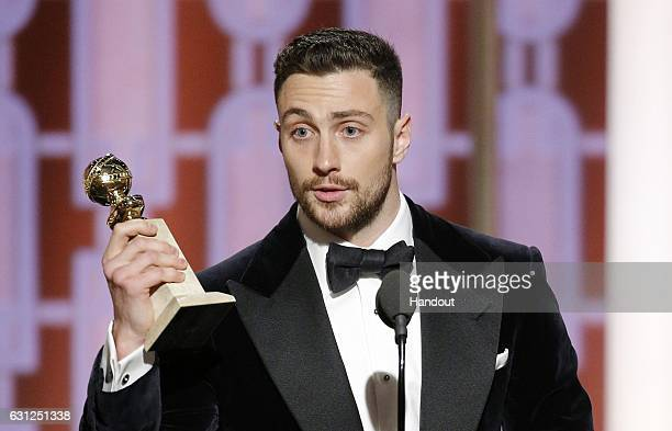 In this handout photo provided by NBCUniversal Aaron TaylorJohnson accepts the award for Best Supporting Actor In A Motion Picture for his role in...