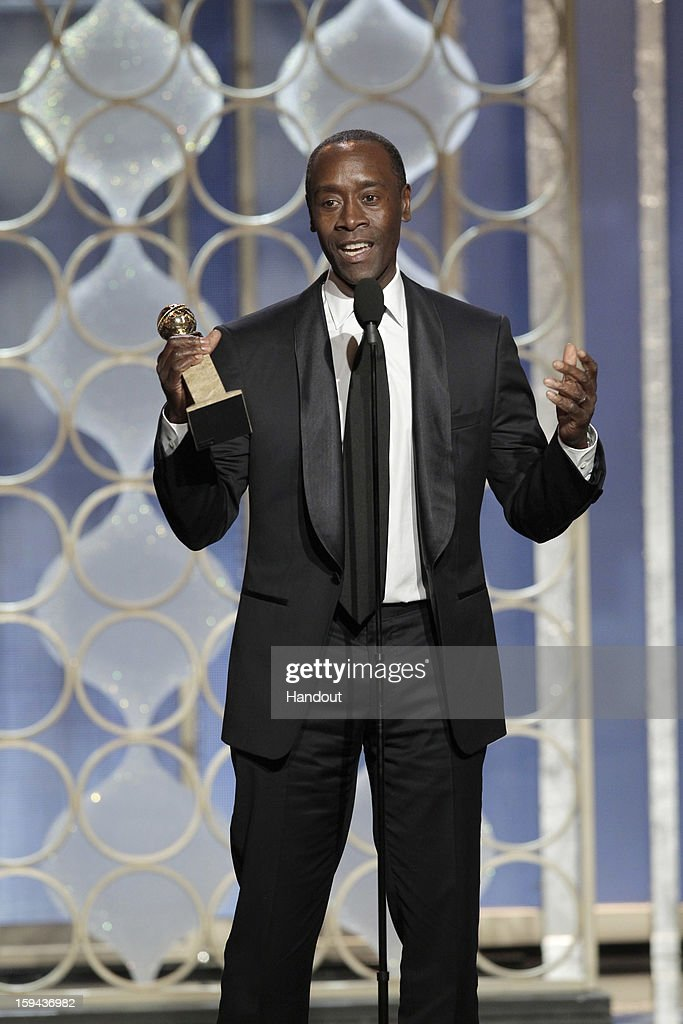 In this handout photo provided by NBCUniversal, Actor Don Cheadle accepts the Best Actor award for TV Series, Comedy or Musical, 'House of Lies' on stage during the 70th Annual Golden Globe Awards at the Beverly Hilton Hotel International Ballroom on January 13, 2013 in Beverly Hills, California.