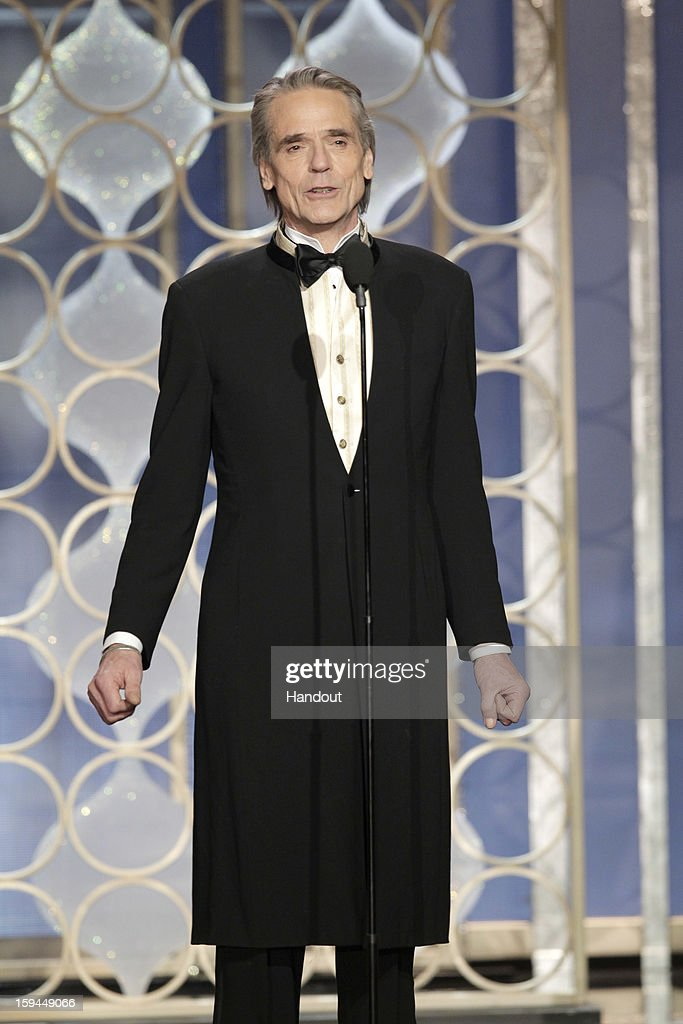 In this handout photo provided by NBCUniversal, Actor <a gi-track='captionPersonalityLinkClicked' href=/galleries/search?phrase=Jeremy+Irons&family=editorial&specificpeople=203309 ng-click='$event.stopPropagation()'>Jeremy Irons</a> on stage to present during the 70th Annual Golden Globe Awards at the Beverly Hilton Hotel International Ballroom on January 13, 2013 in Beverly Hills, California.