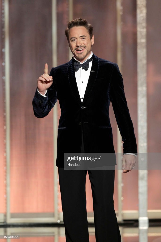 In this handout photo provided by NBCUniversal, Actor Robert Downey, Jr. on stage to present during the 70th Annual Golden Globe Awards at the Beverly Hilton Hotel International Ballroom on January 13, 2013 in Beverly Hills, California.