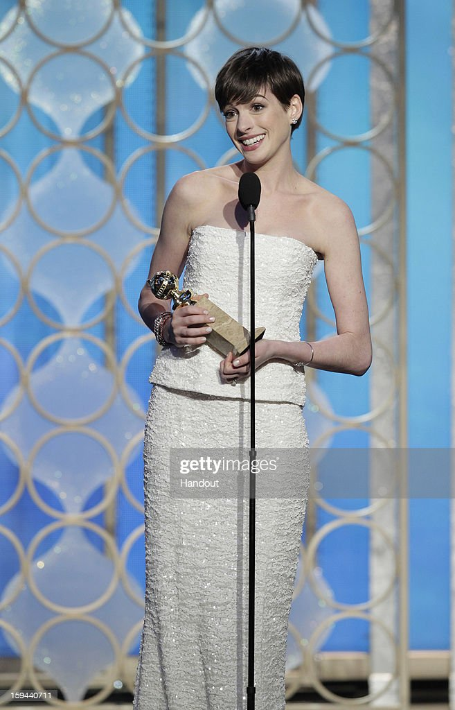 In this handout photo provided by NBCUniversal, Actress <a gi-track='captionPersonalityLinkClicked' href=/galleries/search?phrase=Anne+Hathaway+-+Actress&family=editorial&specificpeople=11647173 ng-click='$event.stopPropagation()'>Anne Hathaway</a> accepts the Best Supporting Actress award for Motion Picture, 'Les Miserables' on stage during the 70th Annual Golden Globe Awards at the Beverly Hilton Hotel International Ballroom on January 13, 2013 in Beverly Hills, California.