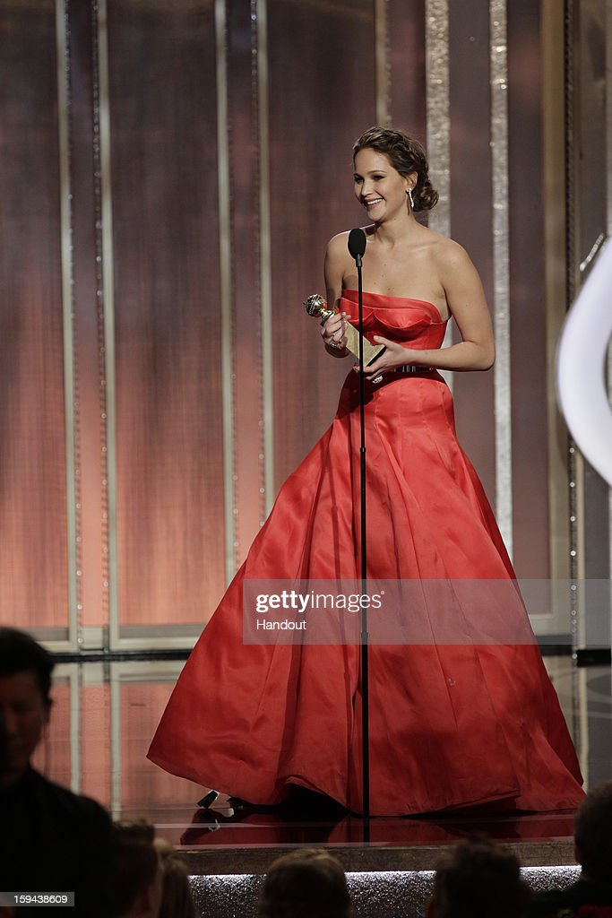 In this handout photo provided by NBCUniversal, Actress Jennifer Lawrence accepts the Best Actress award for Motion Picture, Comedy or Musical on stage during the 70th Annual Golden Globe Awards at the Beverly Hilton Hotel International Ballroom on January 13, 2013 in Beverly Hills, California.