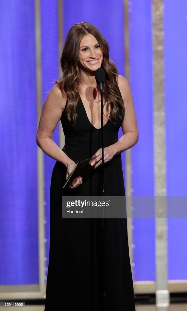 In this handout photo provided by NBCUniversal, Actress <a gi-track='captionPersonalityLinkClicked' href=/galleries/search?phrase=Julia+Roberts&family=editorial&specificpeople=202605 ng-click='$event.stopPropagation()'>Julia Roberts</a> on stage to present during the 70th Annual Golden Globe Awards at the Beverly Hilton Hotel International Ballroom on January 13, 2013 in Beverly Hills, California.