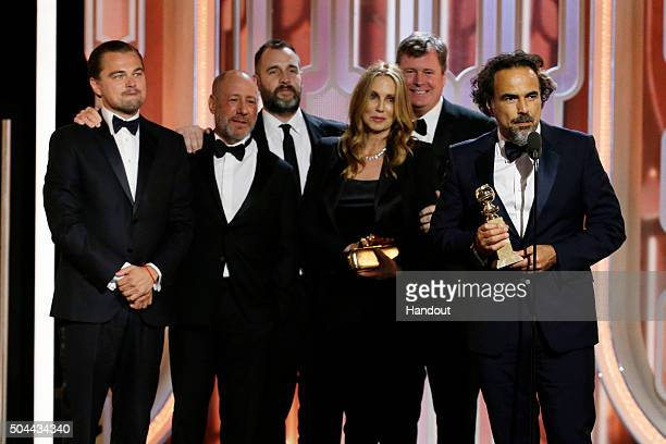 In this handout photo provided by NBCUniversal Alejandro G Inarritu accepts the award for Best Motion Picture Drama for 'The Revenant' during the...