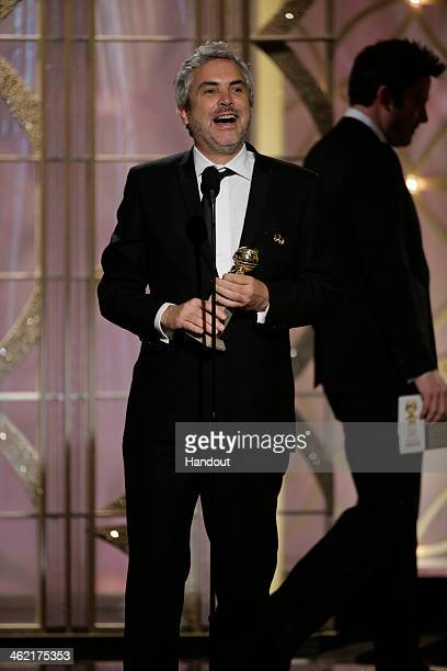 In this handout photo provided by NBCUniversal Alfonso Cuaron accepts the award for Best Director Motion Picture for 'Gravity' during the 71st Annual...