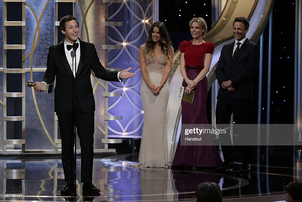 In this handout photo provided by NBCUniversal Andy Samberg accepts the award for Best Actor in a TV Series Musical or Comedy for 'Brooklyn NineNine'...