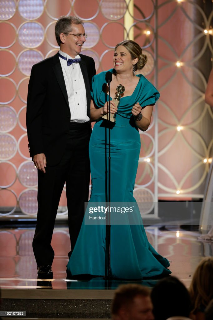 In this handout photo provided by NBCUniversal Chris Buck and Jennifer Lee accept the award for Best Animated Feature Film for 'Frozen' during the...