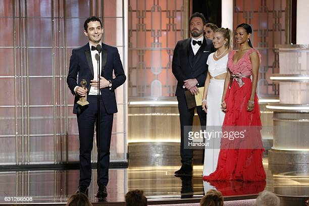In this handout photo provided by NBCUniversal Damien Chazelle accepts the award for Best Director Motion Picture for ' La La Land' onstage during...