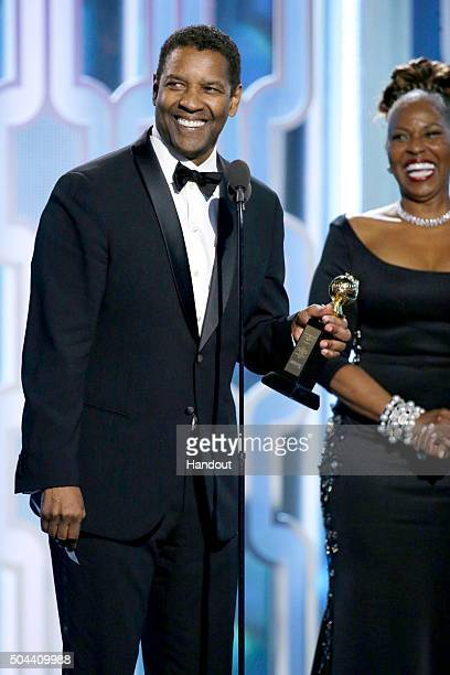 In this handout photo provided by NBCUniversal Denzel Washington accepts with Cecil B Demille Award during the 73rd Annual Golden Globe Awards at The...
