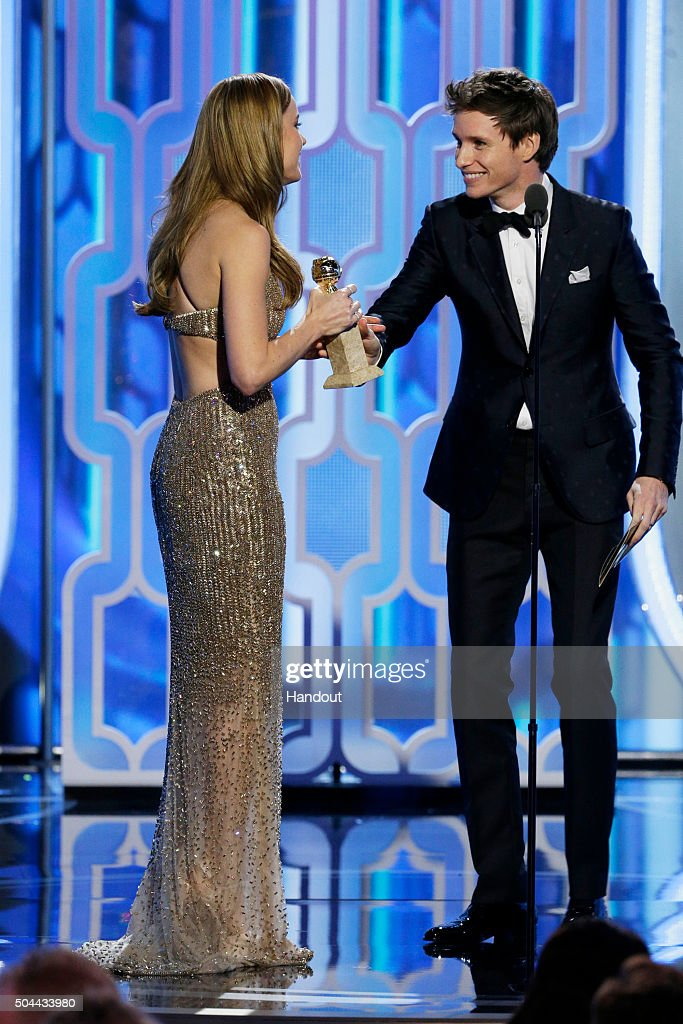 In this handout photo provided by NBCUniversal, Eddie Redmayne (R) presents Brie Larson with the award for Best Actress - Motion Picture, Drama for 'Room' during the 73rd Annual Golden Globe Awards at The Beverly Hilton Hotel on January 10, 2016 in Beverly Hills, California.