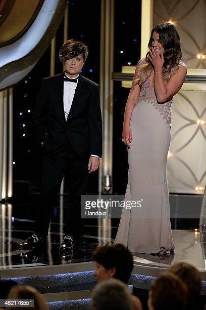 In this handout photo provided by NBCUniversal Host Amy Poehler and Miss Golden Globe Sosie Bacon speak onstage during the 71st Annual Golden Globe...