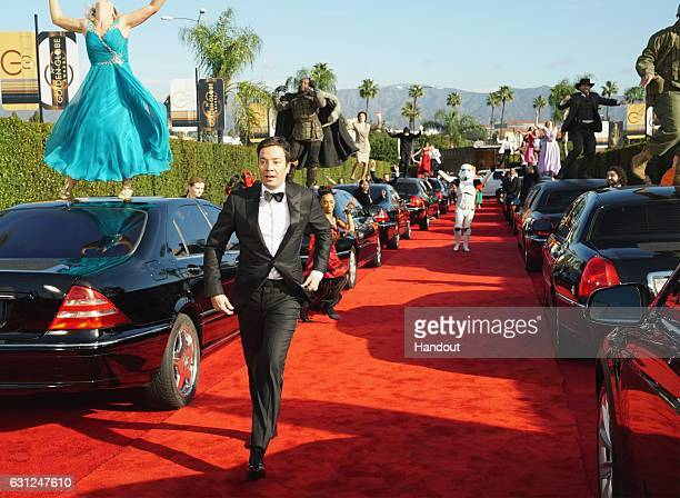 In this handout photo provided by NBCUniversal host Jimmy Fallon performs in the opening sequence for the 74th Annual Golden Globe Awards at The...