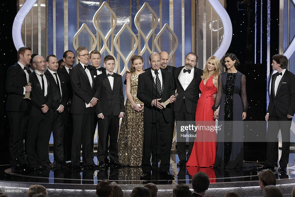 In this handout photo provided by NBCUniversal Howard Gordon Executive Producer accepts the Best TV Series Drama award for 'Homeland' on stage during...
