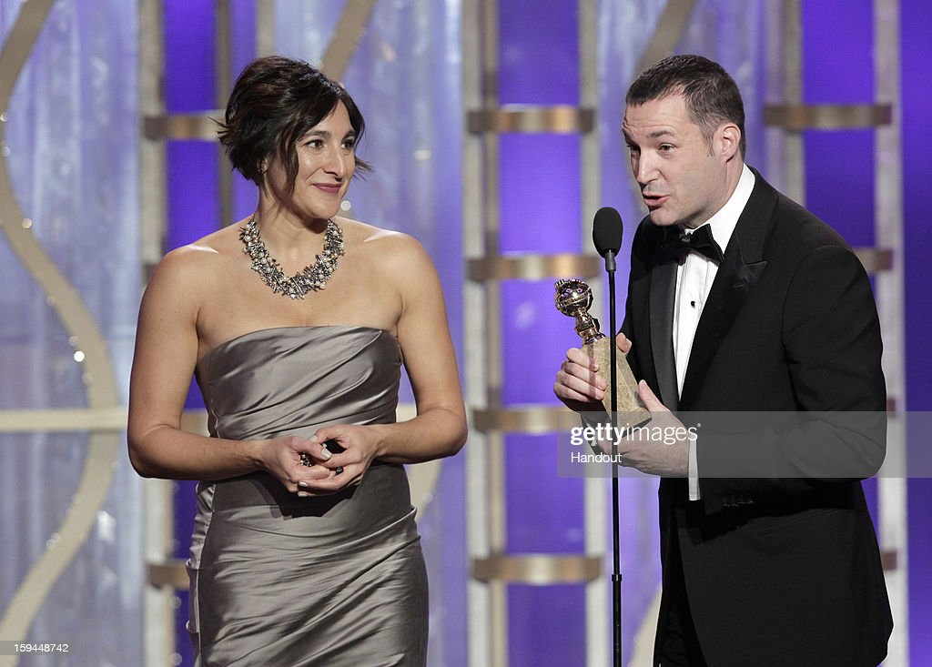 In this handout photo provided by NBCUniversal, Katherine Sarafian, Executive Producer and Mark Andrews, Director accept the award for Best Animated Feature Film, 'Brave' on stage during the 70th Annual Golden Globe Awards at the Beverly Hilton Hotel International Ballroom on January 13, 2013 in Beverly Hills, California.