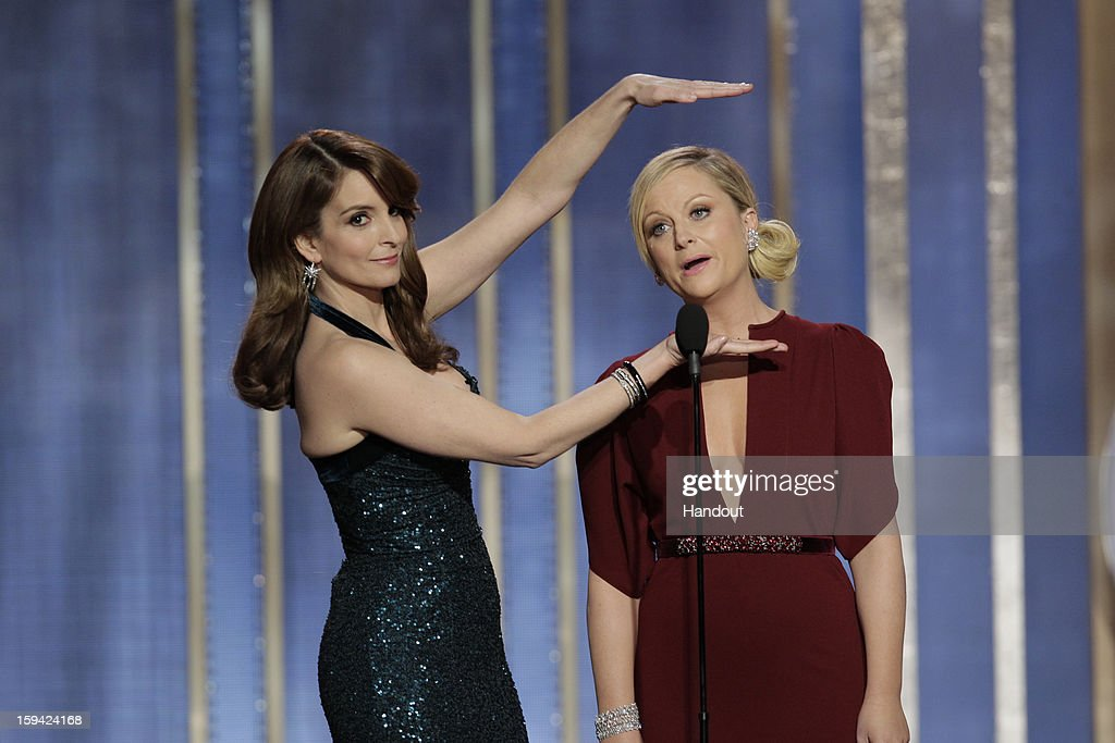 In this handout photo provided by NBCUniversal, L to R <a gi-track='captionPersonalityLinkClicked' href=/galleries/search?phrase=Tina+Fey&family=editorial&specificpeople=206753 ng-click='$event.stopPropagation()'>Tina Fey</a> and <a gi-track='captionPersonalityLinkClicked' href=/galleries/search?phrase=Amy+Poehler&family=editorial&specificpeople=228430 ng-click='$event.stopPropagation()'>Amy Poehler</a> host the 70th Annual Golden Globe Awards at the Beverly Hilton Hotel International Ballroom on January 13, 2013 in Beverly Hills, California.