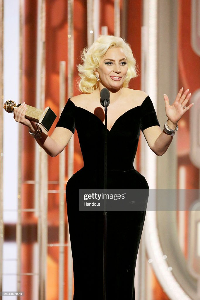 In this handout photo provided by NBCUniversal, Lady Gaga accepts the award for Best Actress - Limited Series or TV Movie for 'American Horror Story: Hotel' during the 73rd Annual Golden Globe Awards at The Beverly Hilton Hotel on January 10, 2016 in Beverly Hills, California.