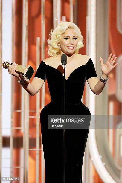 In this handout photo provided by NBCUniversal Lady Gaga accepts the award for Best Actress Limited Series or TV Movie for 'American Horror Story...
