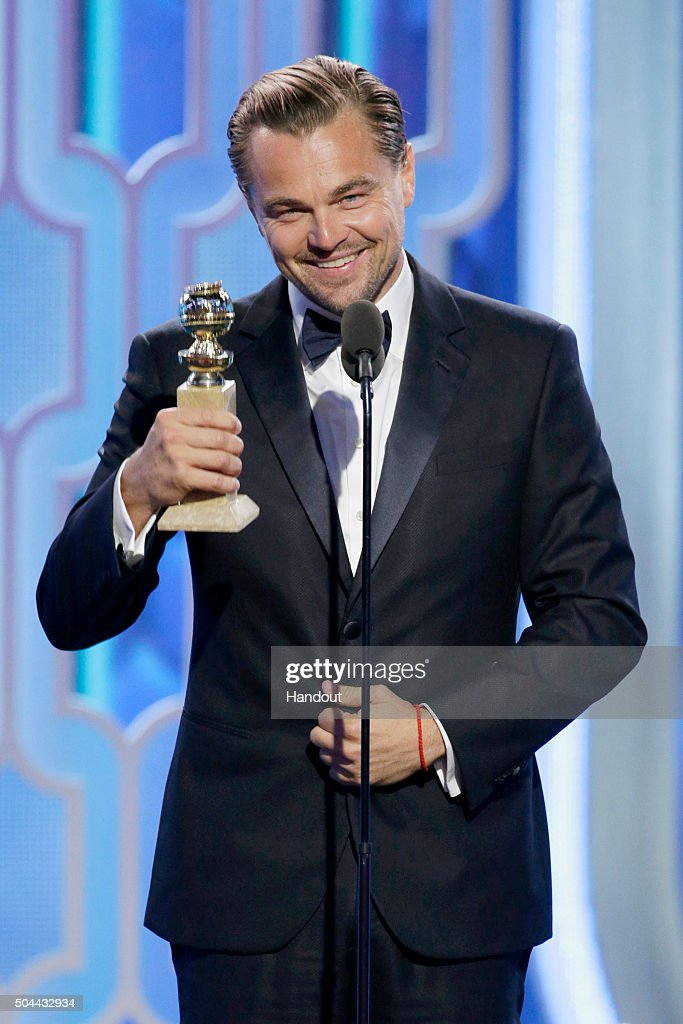 In this handout photo provided by NBCUniversal Leonardo DiCaprio accepts the award for Best Actor Motion Picture Drama for 'The Revenant' during the...