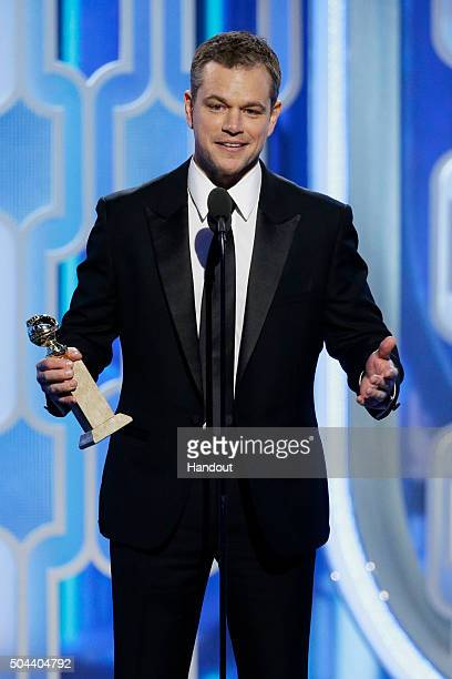 In this handout photo provided by NBCUniversal Matt Damon accepts the award for Best Actor Motion Picture Comedy onstage for 'The Martian' during the...