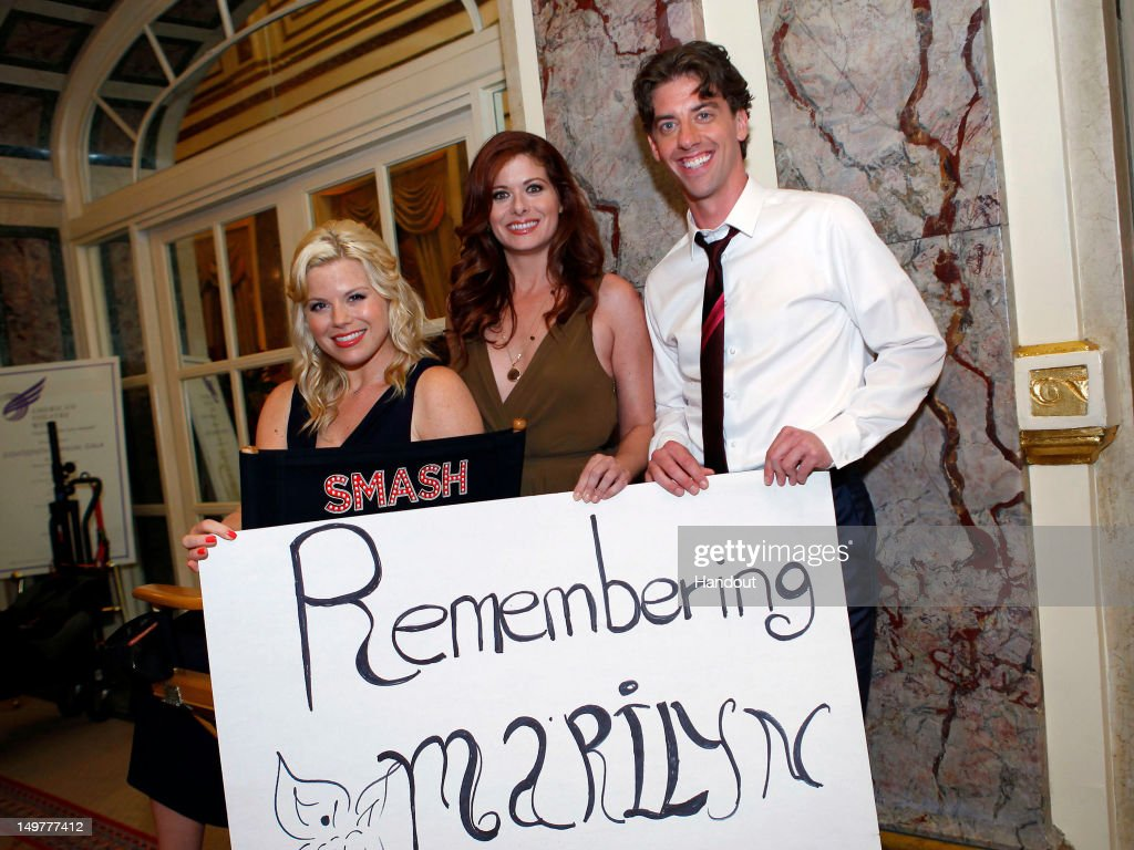 In this handout photo provided by NBCUniversal Media, (L-R) 'Smash' cast members Megan Hilty, Debra Messing and Christian Borle commemorate the 50th anniversary of Marilyn Monroe's passing on August 3, 2012 in New York City.