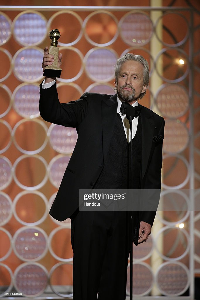 In this handout photo provided by NBCUniversal Michael Douglas accepts the award for Best Actor in a MiniSeries or TV Movie for 'Behind the...