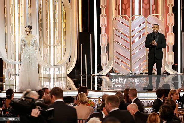 In this handout photo provided by NBCUniversal Miss Golden Globe Corinne Foxx and Jamie Foxx onstage during the 73rd Annual Golden Globe Awards at...