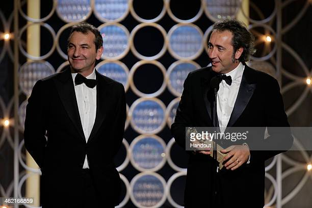 In this handout photo provided by NBCUniversal Nicola Giuliano and Paolo Sorrentino accept the award for Best Foreign Language Film for 'The Great...