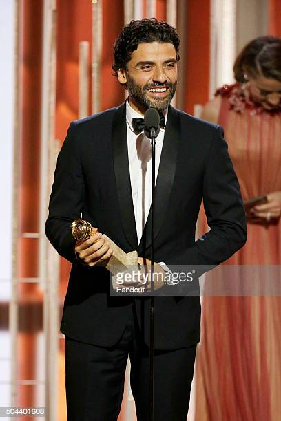 In this handout photo provided by NBCUniversal Oscar Isaac accepts the award for Best Actor Limited Series or TV Movie for 'Show Me A Hero' during...