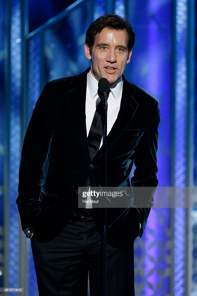 In this handout photo provided by NBCUniversal Presenter Clive Owen speaks onstage during the 72nd Annual Golden Globe Awards at The Beverly Hilton...